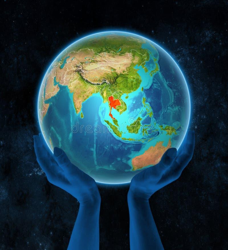 地球上的泰国在空间的手上 向量例证