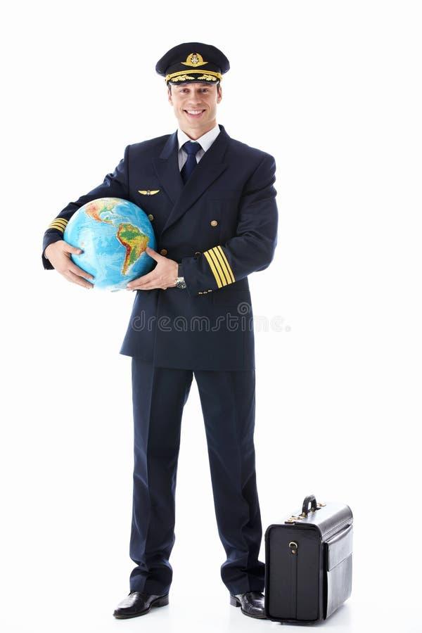 地球和手提箱的飞行员 免版税库存照片