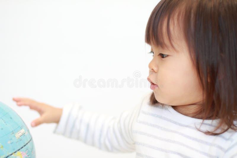 地球和日本女孩 库存照片