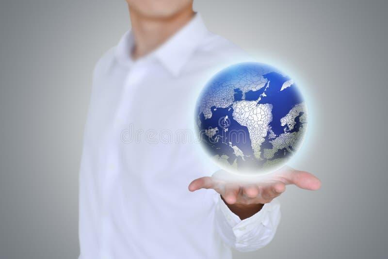 地球在人的手上漂浮 库存图片