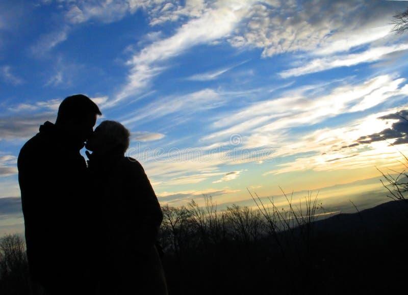 地球天堂亲吻 库存图片
