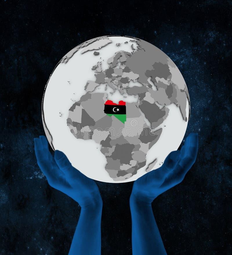 地球的利比亚在手上 库存例证