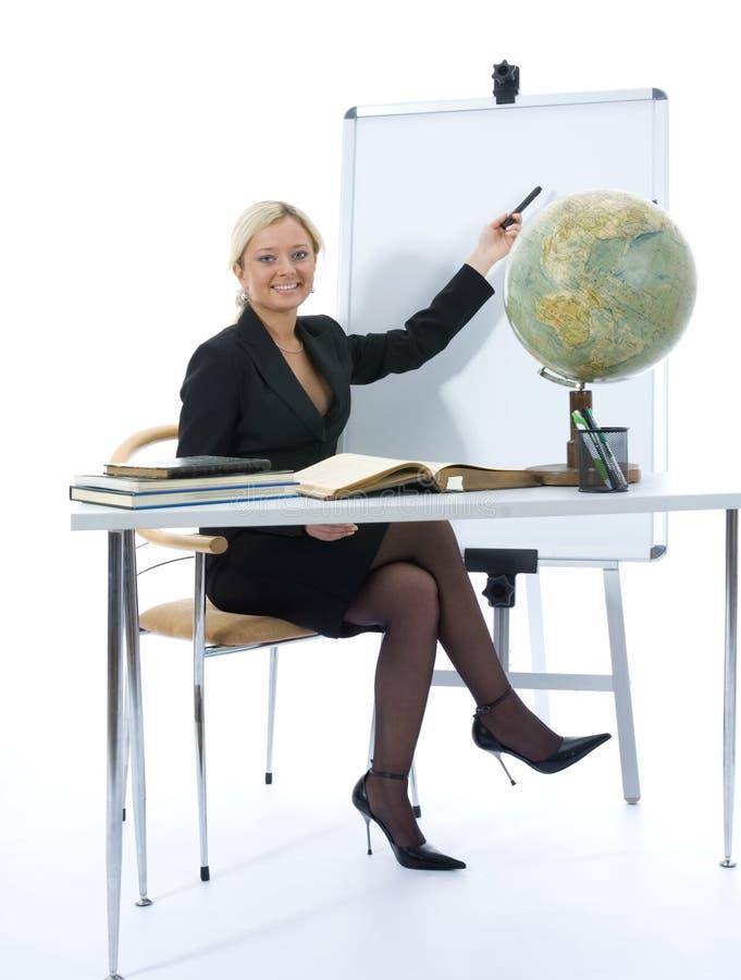 地理教教师将年轻人 免版税库存图片