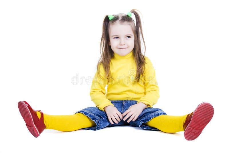 地面的女孩一点 库存图片