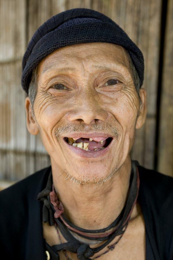 坏老挝笑的人老牙 库存照片