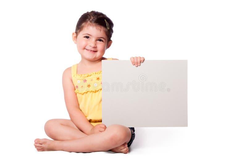 坐与whiteboard的愉快的女孩 库存照片