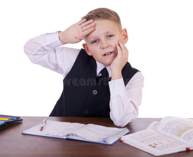 坐在书桌的十年高中学生 图库摄影