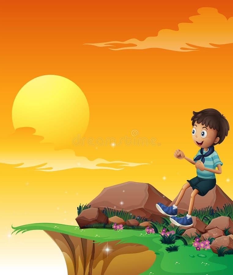 坐在大岩石的一个愉快的男孩在峭壁附近 皇族释放例证