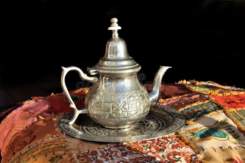 坐垫休息的茶壶 图库摄影