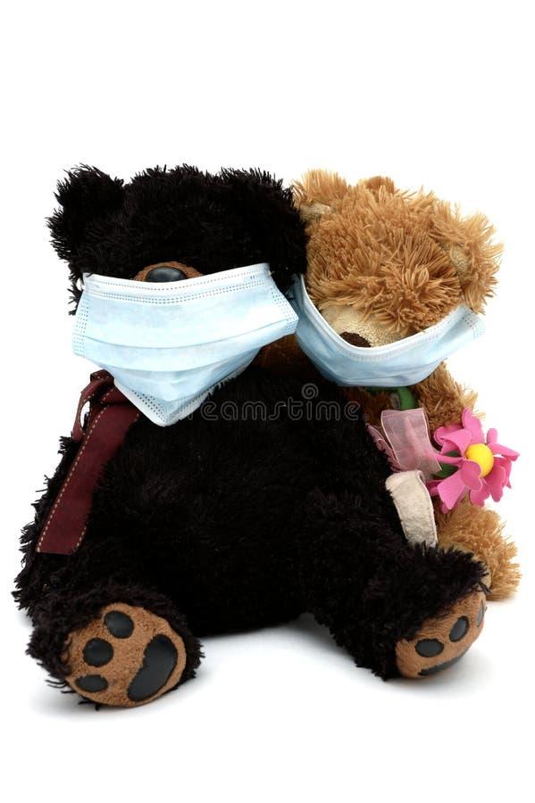 坐女用连杉衬裤的熊屏蔽 图库摄影
