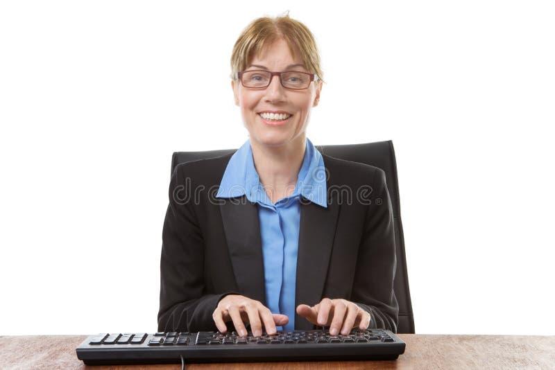 坐的办公室工作者 库存图片