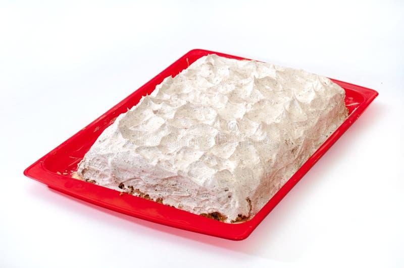 结块与在塑料盘子的打好的奶油 库存照片