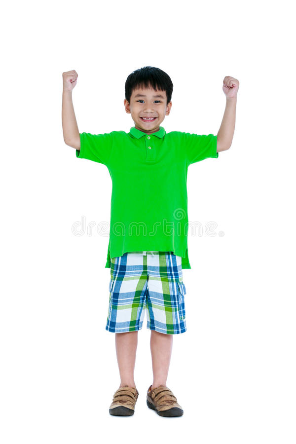 坚强和确信的孩子 愉快亚洲儿童微笑和葡萄干 免版税库存图片