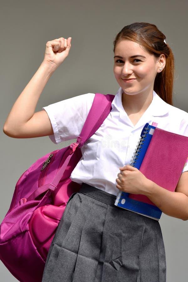 坚强的学校女孩佩带的校服 库存照片
