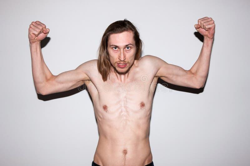 坚强的肌肉的人 成人自满的男性 图库摄影