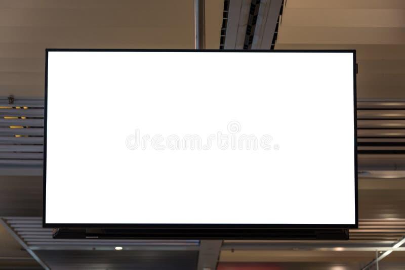 垂悬从天花板的空白的广告空间屏幕 免版税库存照片