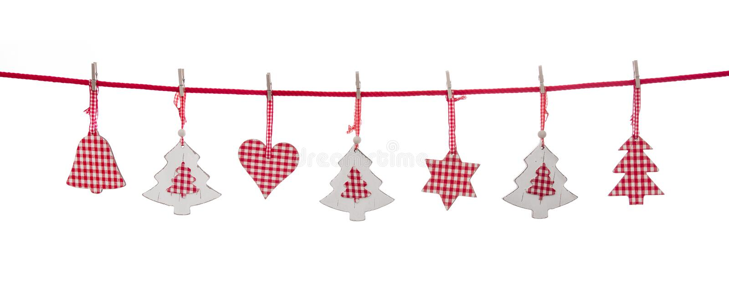 垂悬在线的被隔绝的红色和白色圣诞节装饰 免版税图库摄影