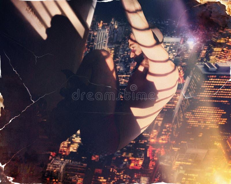 垂悬从大厦的英雄 免版税库存图片