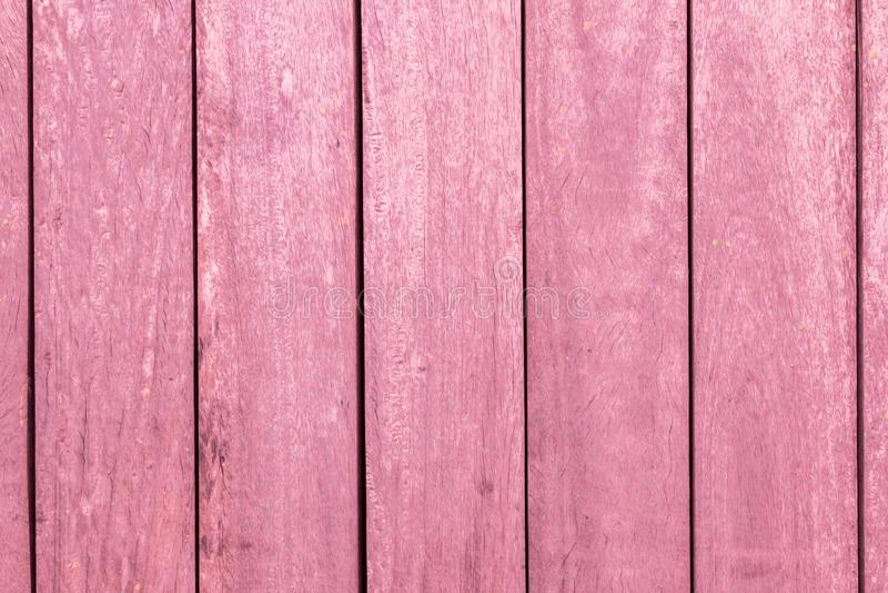 垂直的桃红色木酒吧构造背景 库存图片