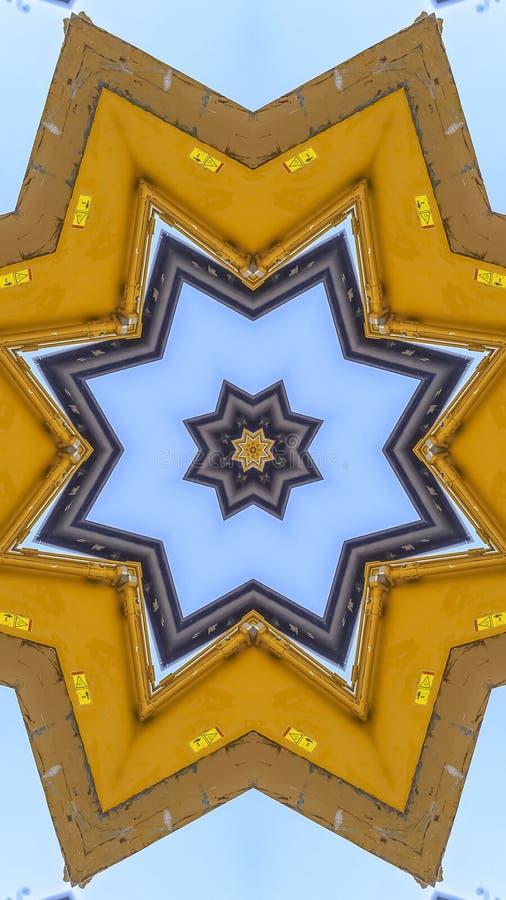 垂直的A指向了由一台黄色拖拉机做的星形状 库存图片