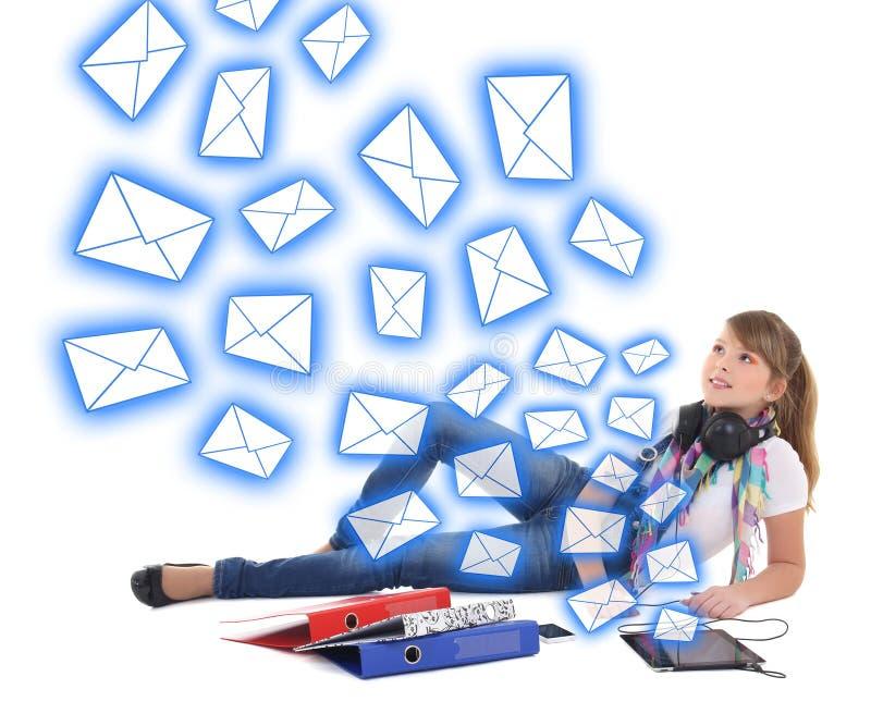 垃圾短信概念-有片剂个人计算机的美丽的十几岁的女孩 库存照片
