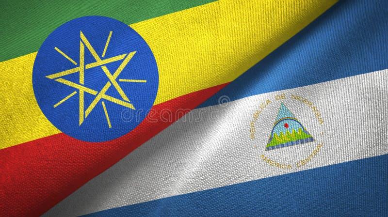 埃塞俄比亚和尼加拉瓜两旗子纺织品布料,织品纹理 皇族释放例证