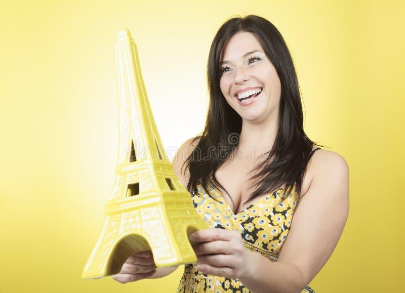 埃菲尔游览妇女黄色 免版税库存图片