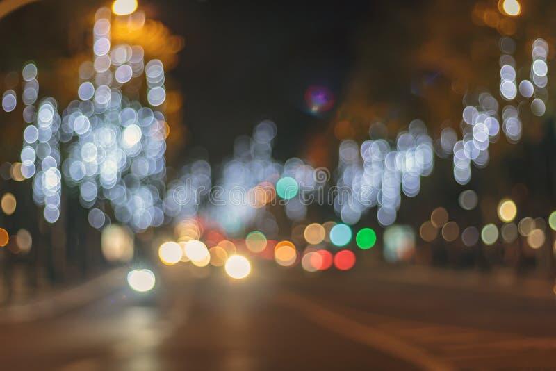 城市夜摘要bokeh轻的背景  免版税库存图片
