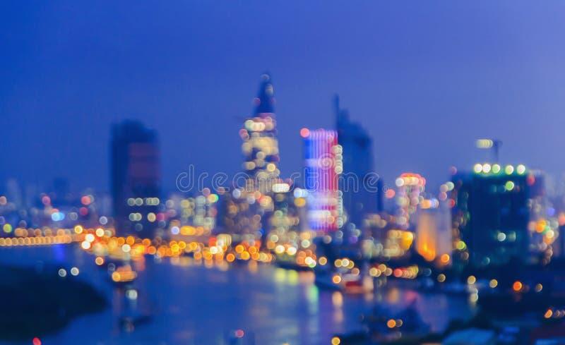 城市点燃在蓝色背景的大抽象圆bokeh 库存图片