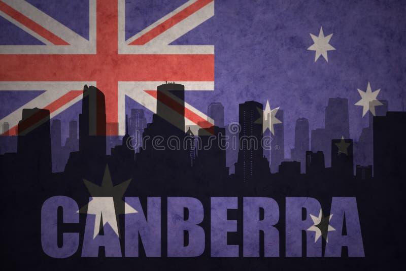 城市的抽象剪影有文本的堪培拉在葡萄酒澳大利亚人旗子 向量例证
