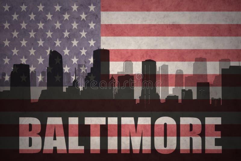 城市的抽象剪影有文本的巴尔的摩在葡萄酒美国国旗 库存照片
