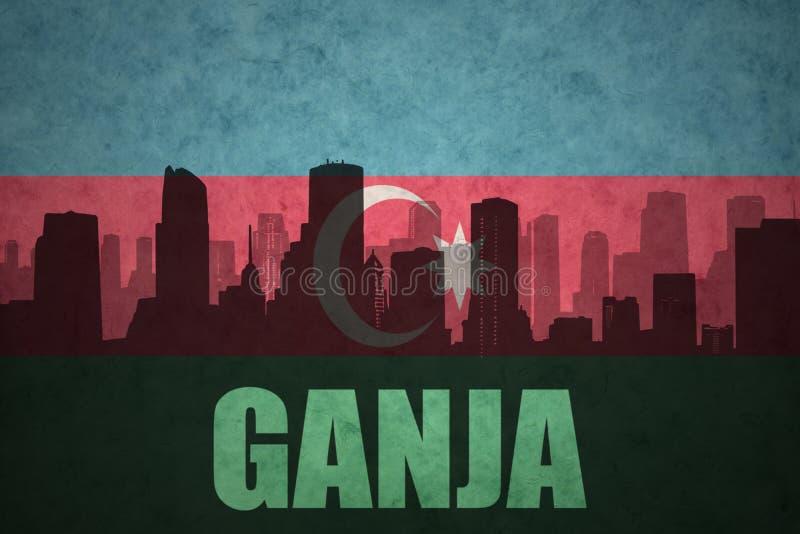 城市的抽象剪影有文本的Ganja在葡萄酒阿塞拜疆旗子 免版税库存图片