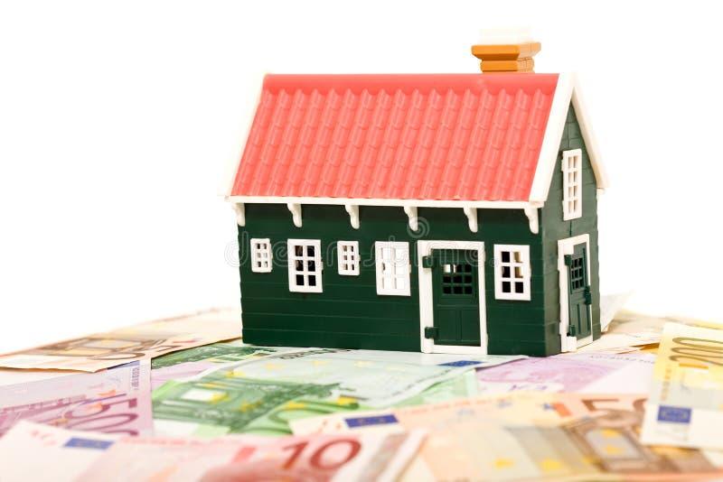 域基础房子查出货币 免版税库存图片