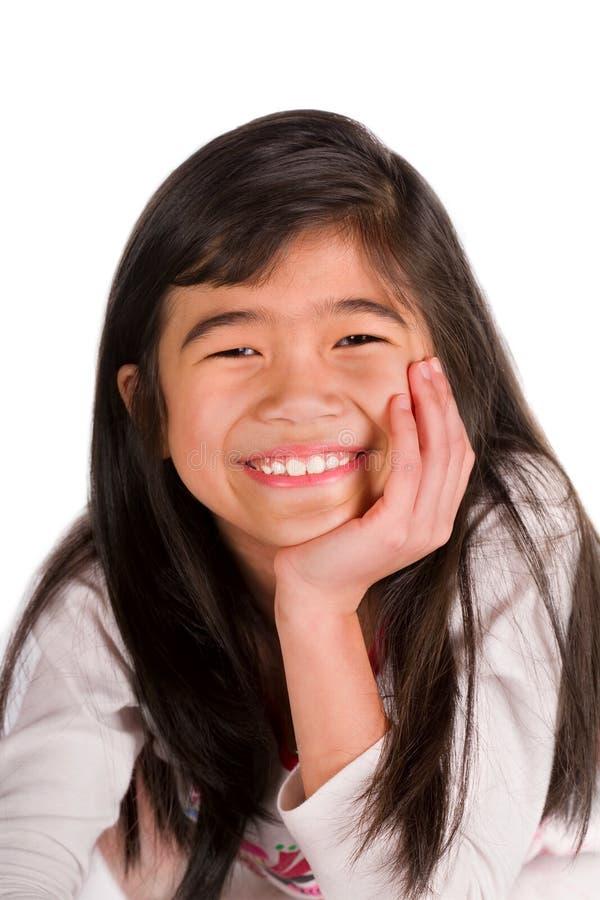基于地板的小女孩,在手边朝向 图库摄影