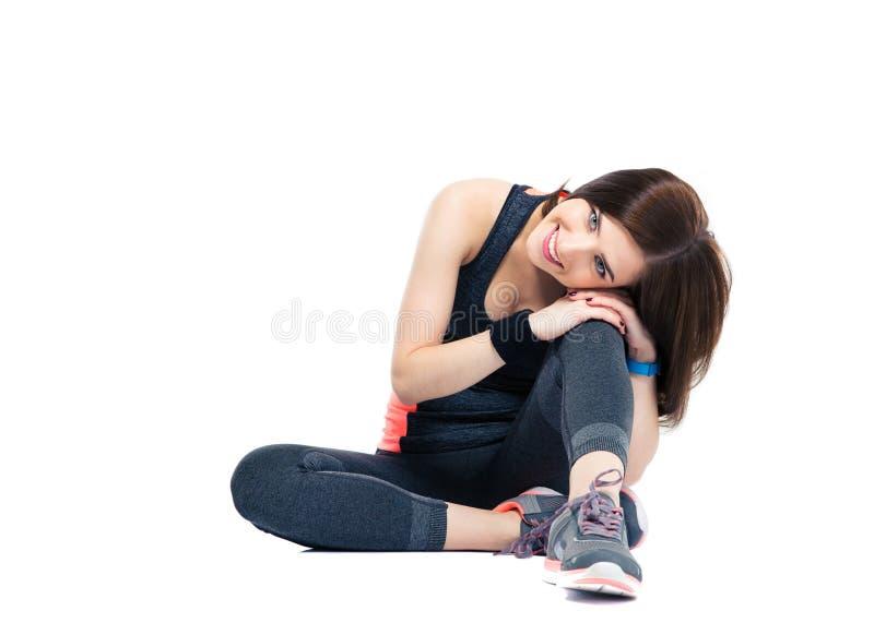 基于地板的微笑的体育妇女 免版税图库摄影