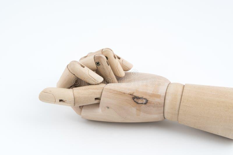 基于桌的一只被联接的木手的姿态 库存照片