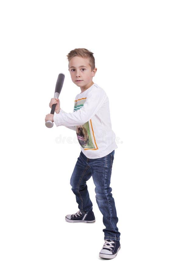 基本的男孩摇摆的棒球棒 免版税库存图片