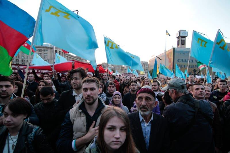 基辅,乌克兰- 2015年5月18日, :克里米亚半岛鞑靼人庆祝克里米亚半岛鞑靼人的牵强的驱逐出境的71th周年从克里米亚的 免版税图库摄影