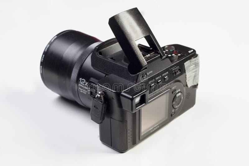 基辅,乌克兰- 2月04 2017年:与后边数字显示的照片乐声牌Lumix DMC-FZ10 mirrorless照相机 免版税库存图片