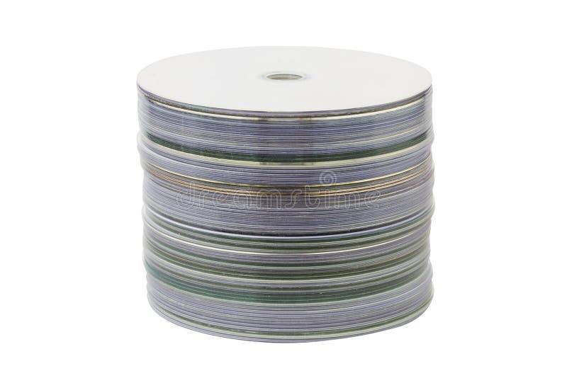 堆与在白色背景隔绝的裁减路线的cd 免版税图库摄影