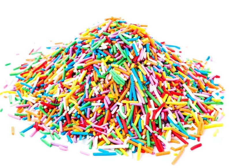 堆五颜六色的甜点糖果在白色backgrou洒隔绝 免版税图库摄影