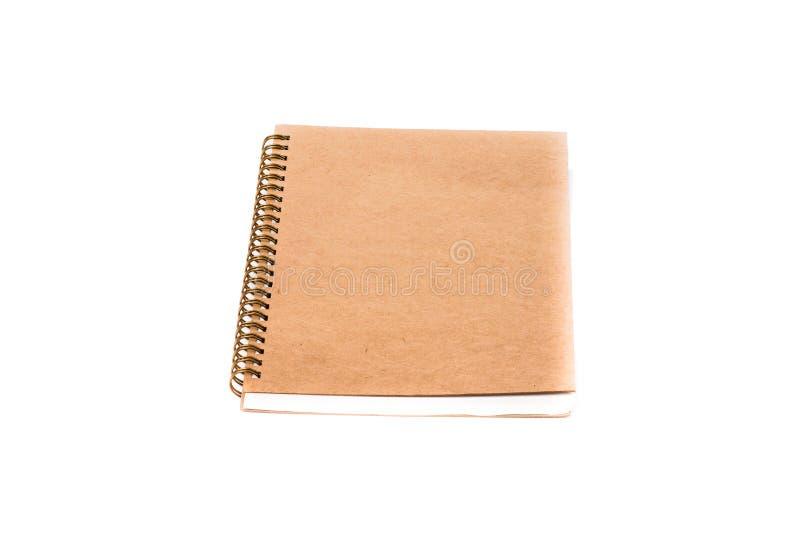 堆在白色和笔记本隔绝的圆环包扎工具书 库存图片