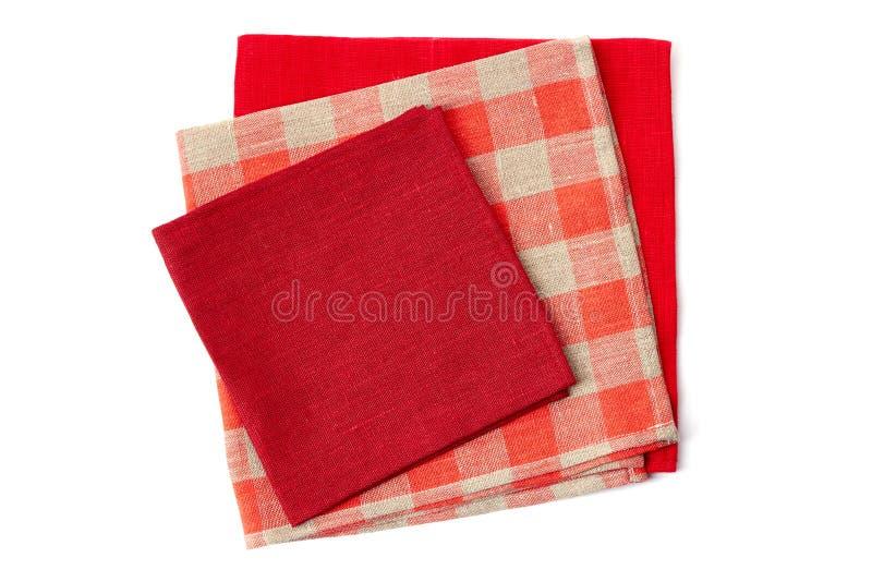堆在白色的三块五颜六色的餐巾 库存照片