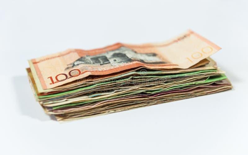 堆在白色背景的国际钞票 图库摄影