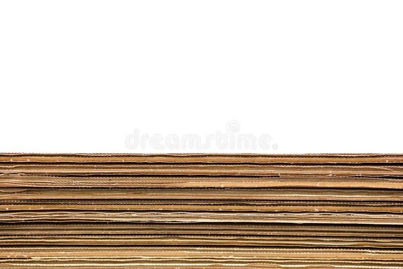 堆在白色背景的皱纸板箱子与拷贝空间 库存图片