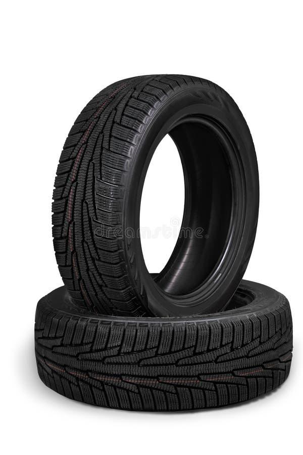 堆在背景隔绝的汽车轮胎 免版税库存图片