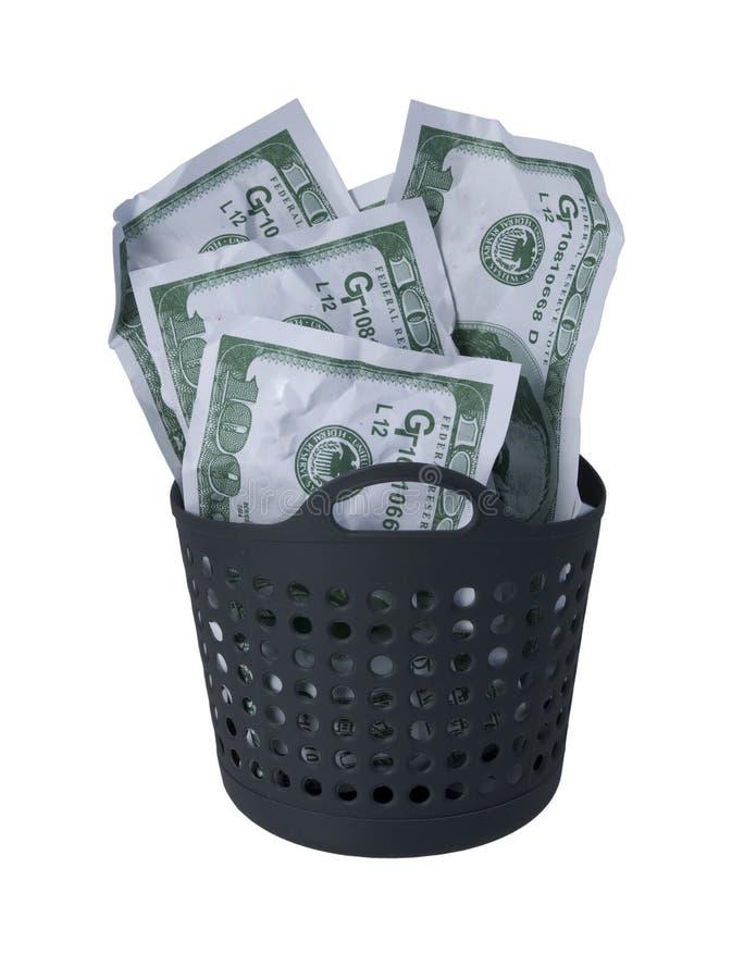 堆在洗衣篮的金钱 免版税库存照片