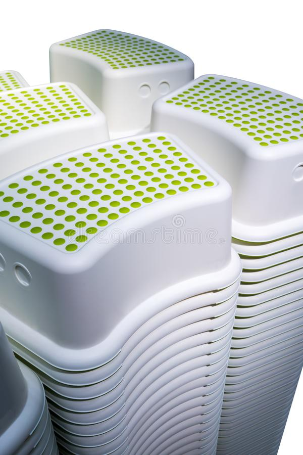 堆微型方形的形状短缺与绿色圆点轻拍的凳子 图库摄影