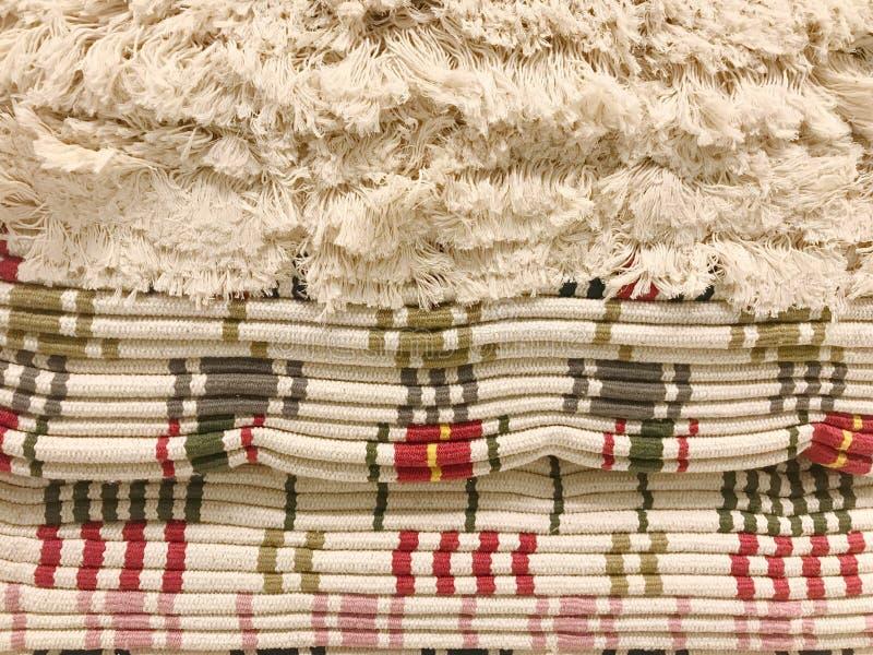 堆有缨子的地毯 免版税库存照片