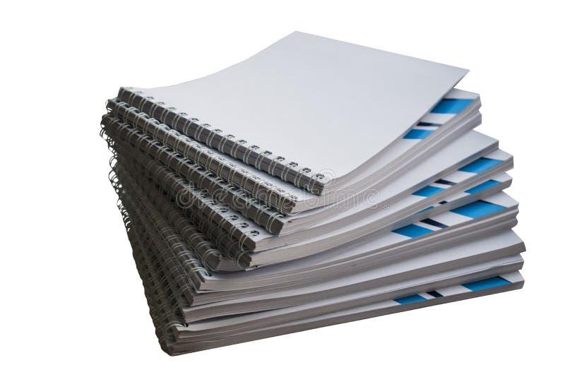 堆有蓝色条纹的笔记本纪录的 免版税库存图片